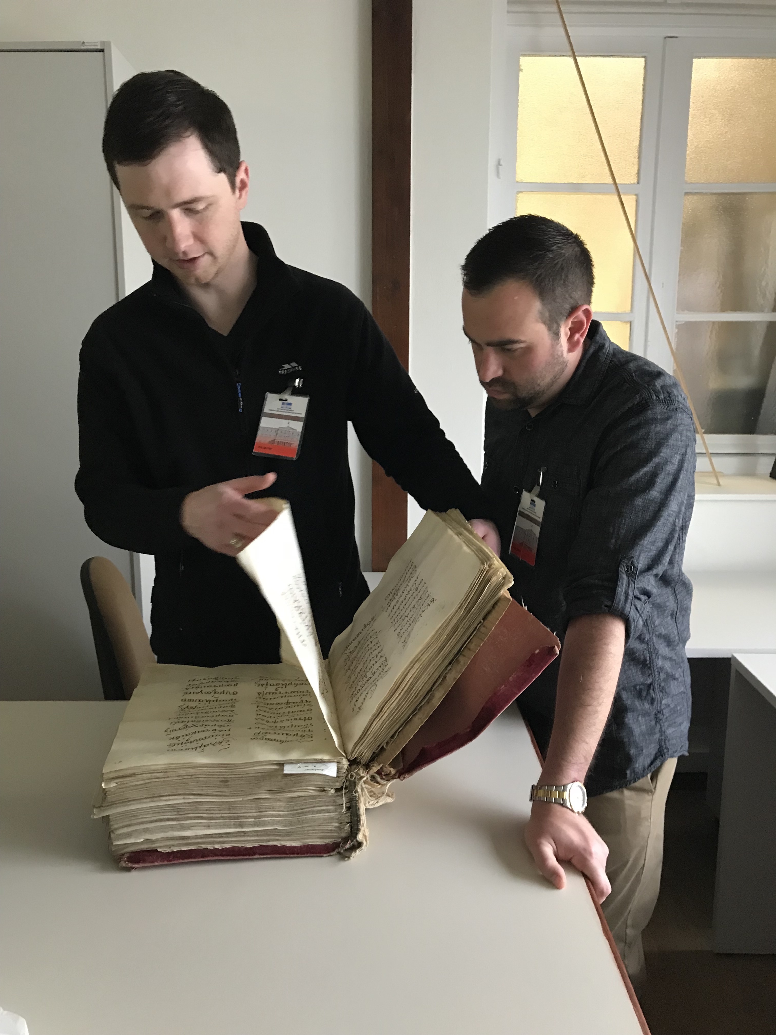 Rob and Jacob examining Lectionary 450